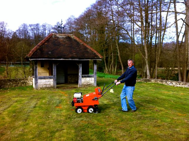 Peter with the turf stripping machine.